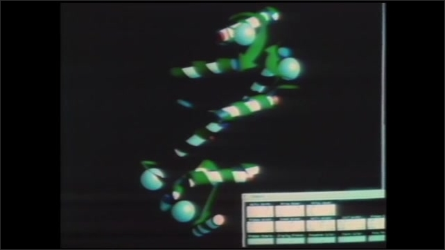 1990s: Lab.  Man turns knob on machine.  Animated models appear on screen.  Colored dots cover image.