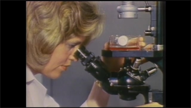 1990s: Woman works in lab.  Scientist looks into microscope.  Animation shows particles settling at bottom of diagram.  Syringes rotate on machine.