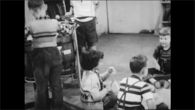 1950s: Panning shots, kids playing instruments in classroom.