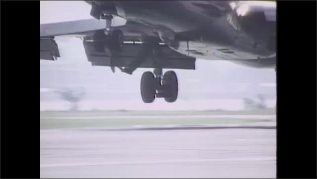 1980s: Jetliner taxis on runway. Jetliner lands on runway. Jetliner takes off at Washington D.C. airport.