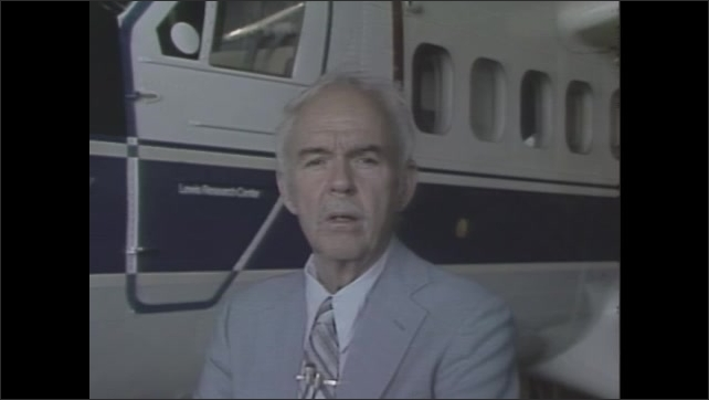 1980s: Jetliner taxis on runway at airport. Man in suit stands next to airplane talking. Title card: Nasa Crop Dusting Research.