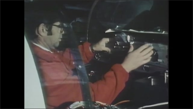 1980s: Electronic equipment. Man sits in cockpit of plane and attaches level and device on top of level. Two men work on tail landing gear of plane.