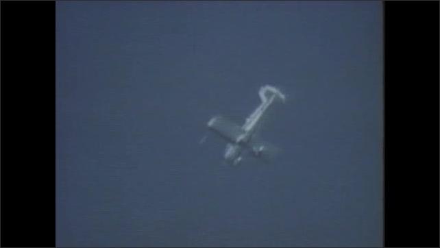 1980s: Airplane flies through air then begins doing a spiral dive.