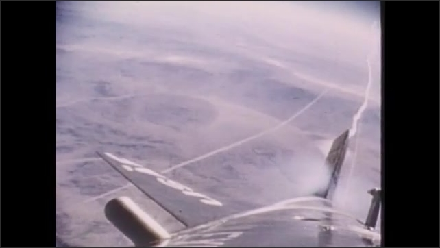 1980s: Needle on altimeter gauge moves. Tail of jet as it flies through air.
