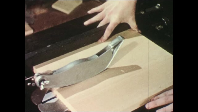 1950s: Jagged metal can, nails stick out of wood. Hand flexes. Person runs wood through power saw. Boy cuts twigs off stick.