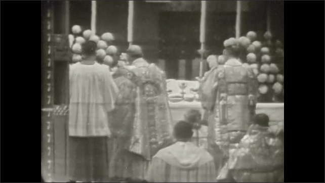 1950s: UNITED STATES: men with incense in church. Men kiss altar. Man takes incense.