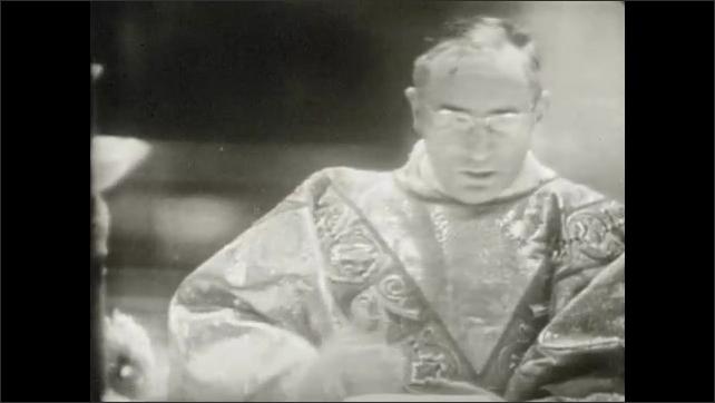 1950s: UNITED STATES: man sings Holy, Holy, Holy. Choir sings songs of praise. Man crosses chest. Man kisses altar.