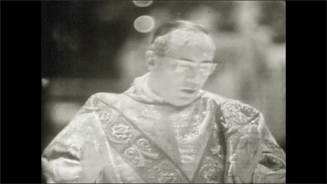 1950s: UNITED STATES: man blesses Holy wine and bread. Choir sings in service. Man says prayer.
