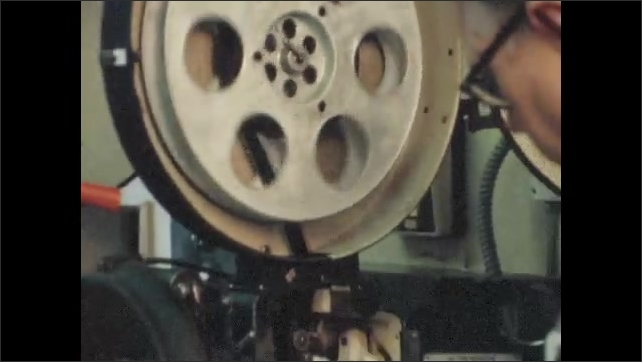 1970s: UNITED STATES: Maryland Estate Board of Censors. Film reel spins on machine.
