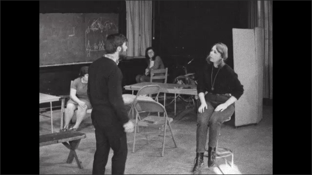 1970s: UNITED STATES: Lady speaks to man on stage. Couple argue. Lady slaps man on face.