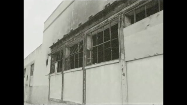 1960s: UNITED STATES: North Avenue Market sign. Broken window in building. Damaged building. Boarded up windows.