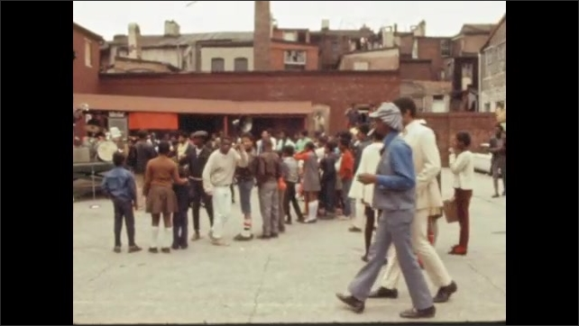 1970s: UNITED STATES: civil rights protest in streets. People from community stand in street. Man speaks in press conference