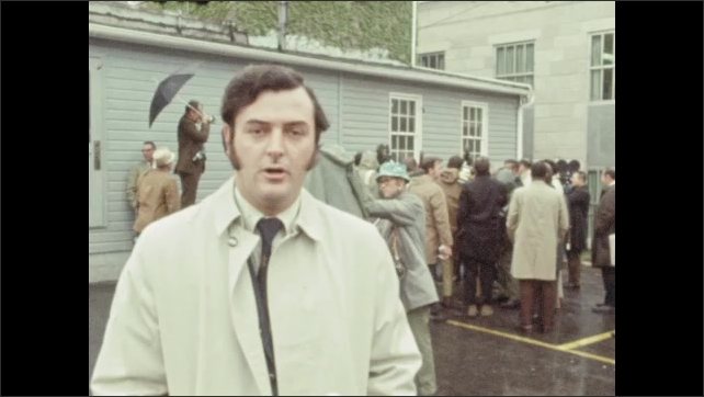 1970s: UNITED STATES: reporter speaks to camera outside court. Press outside court. Man speaks to press