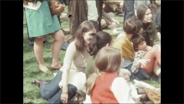 1970s: UNITED STATES: Man speaks to students. University students protest outside building. Students sit on steps. People clap.