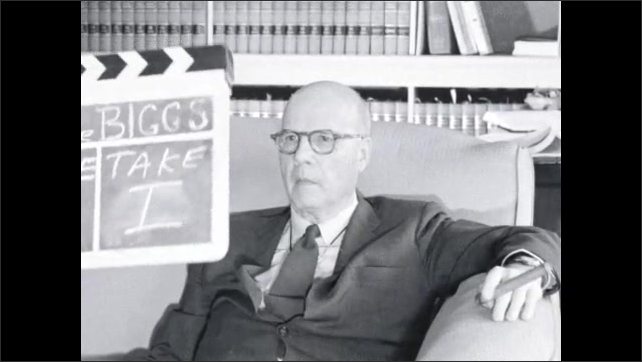 1960s: UNITED STATES: Judge Biggs clapper board. Man in suit sits in chair. Man talks to camera.