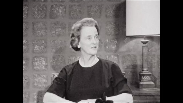 1960s: UNITED STATES: lady in interview. Lady looks at camera. Lady fidgets in seat Lady smiles