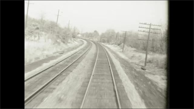 1970s: UNITED STATES: view along tracks from train. Front view from train on tracks.