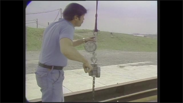 1980s: Man uses winch.  Hill.