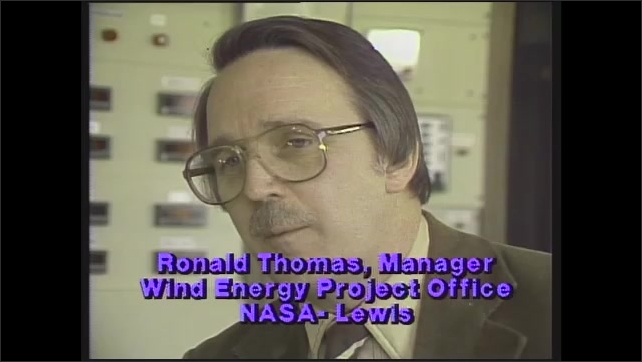 """1980s: Control room.  Men speak.  Caption reads """"Ronald Thomas, Manager.  Wind Energy Project Office.  NASA- Lewis."""""""
