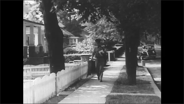 1950s: Flat packages are placed in U.S. Mail box. Mailman walks down sidewalk, opens front gate, and walks up to front door of house.