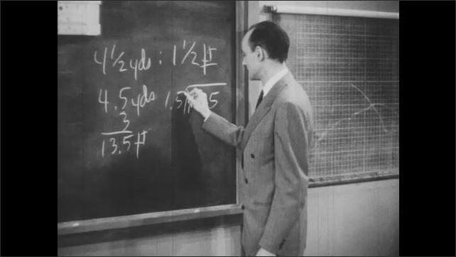 1940s: Teacher solves division problem on blackboard.