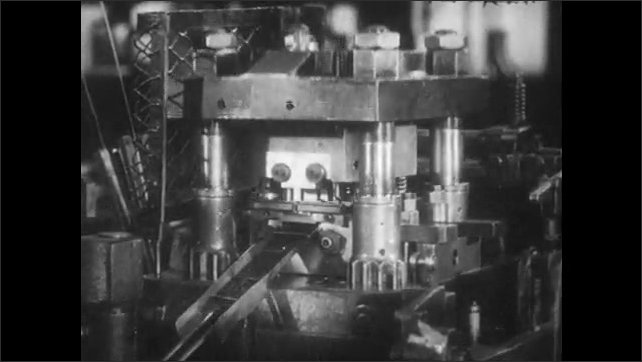 1940s: Man stands at machine, sighs. Man sweeps up sawdust from oil spill. Machine cuts out metal pieces. Man attaches clamp to metal piece.