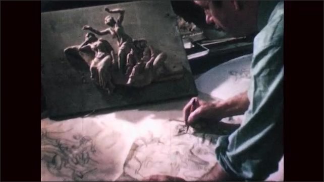1940s: Man sketches mural with clay model situated nearby. Man draws grid on sketch of mural.
