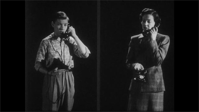 1950s: Boy and woman stand and talk on telephone.