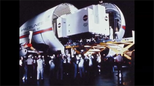 1960s: UNITED STATES: integrated systems checks of vehicle in workshop. Space craft delivery by aircraft.