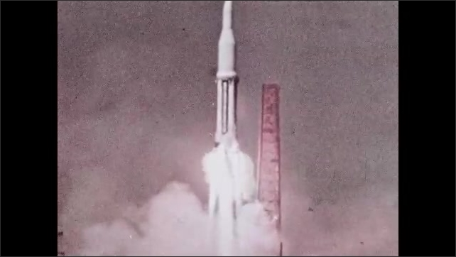 1960s: Rocket blasts into space from launch pad.