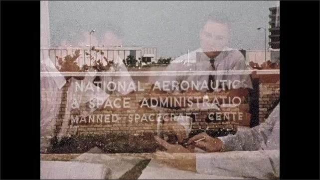 1960s: Three men look at large printouts. Men assist astronaut with clothing. Scientist pours liquid from flask. Men at table in meeting. Sign for NASA Manned Spacecraft Center. Astronaut training.