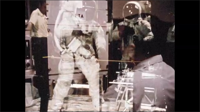 1960s: High angle view of spacecraft. View of monitors. Man at control panel. Astronaut in space suit using drill. Drill pushing through rock. Astronaut with drill.