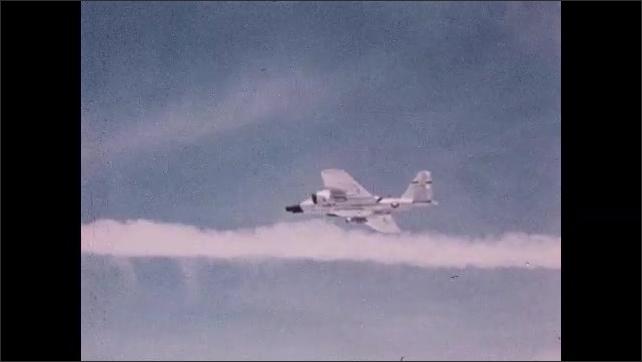 1960s: Jet flying. Dissolve, men with equipment inside plane.