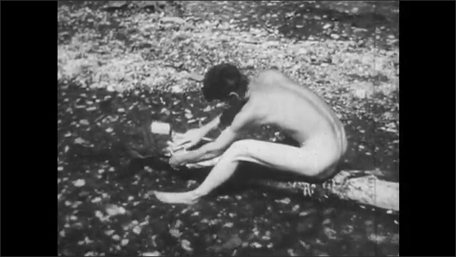 """1940s: Man looks at board reading """"LATEST NEWS.  SOLOMON ISLANDS DOPE.""""  Men bathe and wash clothing in swimming hole.  Soldiers walk through jungle."""
