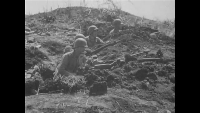 1940s: Soldiers dig trenches.  Soldiers wait in holes.  Airplane.  Ocean.