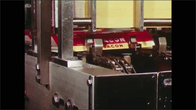 1960s: Stacks of round bologna travel down a conveyor belt. Bacon is packaged by a machine in a factory. Bologna rounds are sealed in plastic in a factory.