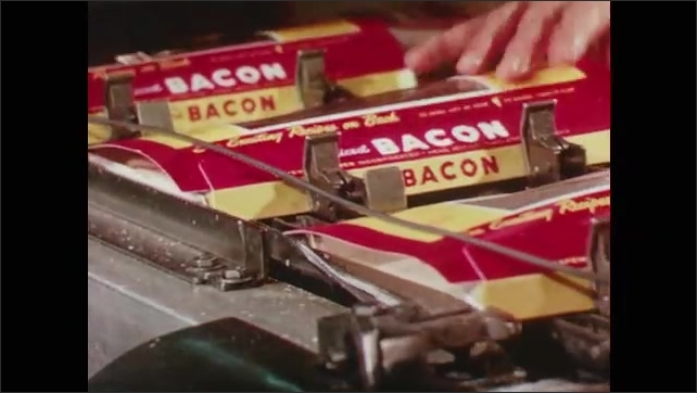 1960s: Bacon is packaged by a machine in a factory. Inspectors look at and reject bacon slices on a factory line.