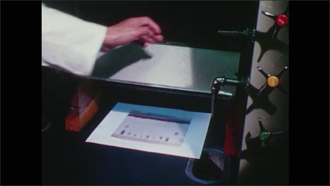 1960s: Scientist exposes paper with samples to ultraviolet light.