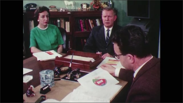 1960s: USDA worker examines a proposed bologna label and discusses it with a team. Design is stamped Approved by Meat Inspection Division, Agriculture Research Services, U.S. Dept. of Agriculture.