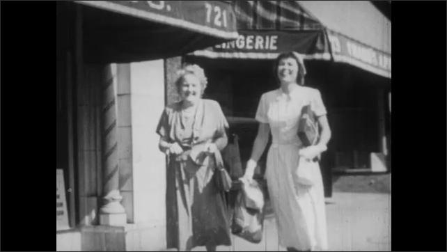 1950s: Four women play bridge and talk. Two women walk down sidewalk and talk.