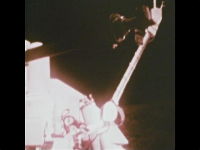 1970s: Robotic arm of Viking Lander retracts.
