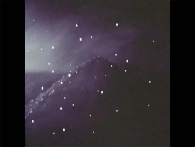 1970s: Gas blows around pile of minerals. Lights flash around pile of minerals.