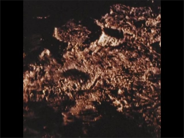 1970s: Outer space.  Parachute unfurls.  Spacecraft lowers itself onto Mars.  Craters.