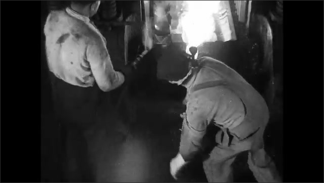 1930s: Man steps on metal plate, metal piece chomps down on hot metal, man moves metal piece as machine smashes it.