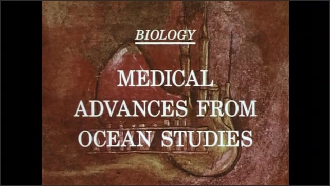 1970s: Men in lab coats work in lab. Title card with text. Ocean waves.