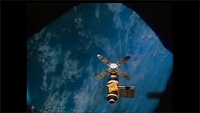 2000s: Clips from the 1973 space programs with astronauts floating in space. Skylab floats in space in 1973. Astronaut maneuvers equipment into space on Skylab. Trial astronaut goes through tests.