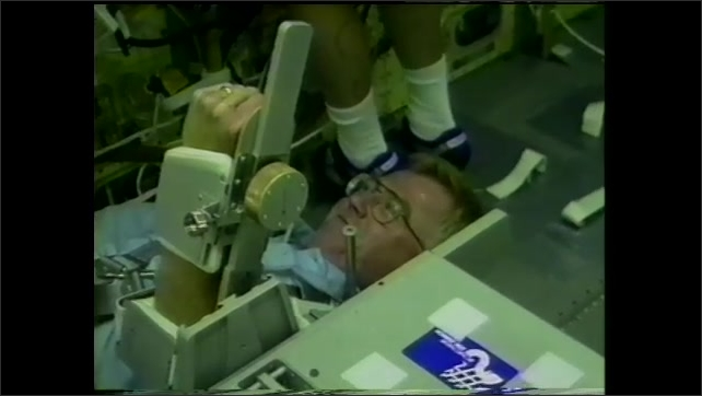 2000s: Astronauts row with oxygen masks and measurement gauges and experiment. Astronauts in space suits jump on the moon next to American flag. Computer animation rendering of astronaut on Mars.