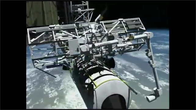 2000s: Computer rendering of robot arms working on the space shuttle. Astronauts in space suits work on exterior of space shuttle.