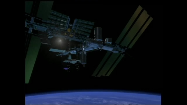 2000s: Computer rendering of space station and the solar arrays turning to catch the sun.