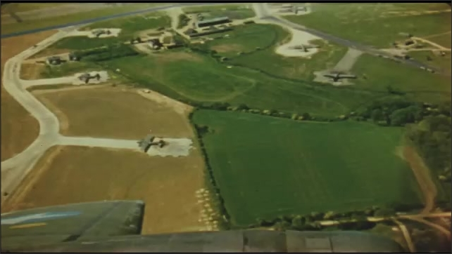 1940s: Aerial view of planes on airstrips. Aerial view of military buildings. Aerial view of planes on airstrips.